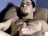 Straight bearish guy Brad gets his hard cut cock sucked...