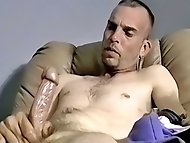 Ryan strokes his hairy cock and shoots a juicy load of...
